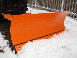 Snow plough attachment on forklift truck front veiw
