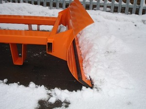 Snow plough attachment on forklift truck side veiw