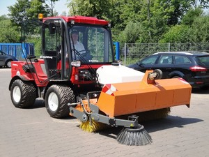 Multihog fitted with Hydraulic Sweeper, c/w hydraulic tipper and water spray system. Used for general yard tidying, estate roads and footpaths etc