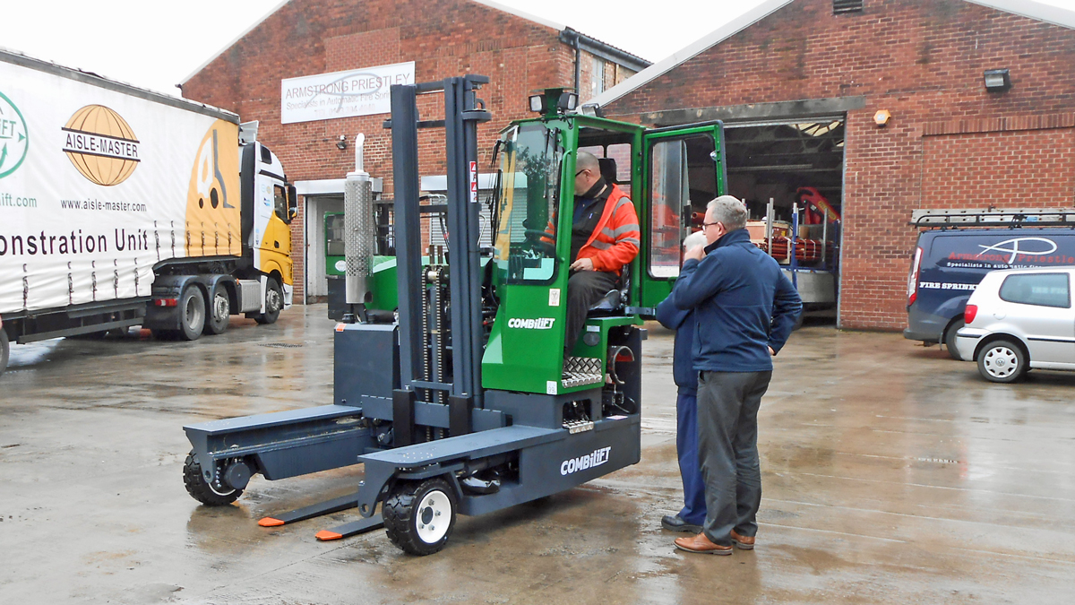 Staff at Armstrong Priestley inspect their new Combilift C3000