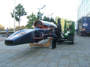 Having been safley unloaded and spun thro' 360 degrees by Ability Handling Ltd's C4000 multi-directional Combilft; the 42 foot 1.1 ton scale model of the Bloodhound SSC 1000MPH Car is carefully placed onto purpose built cradles ready for exhibition at Doncaster College.
