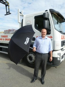 David tries out his new Doosan Golfing Umbrella after winning the prize tickets of a trip to the 2011 Open Championship.