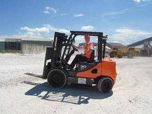 Factory adapated new 3 ton Doosan forklift even does the Limbo in a Sunny Chalk Quarry!