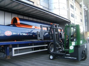 Combilift C4000 with 4m spreader frame unloads 42 foot long Bloohound Super Sonic Car at Doncaster College.